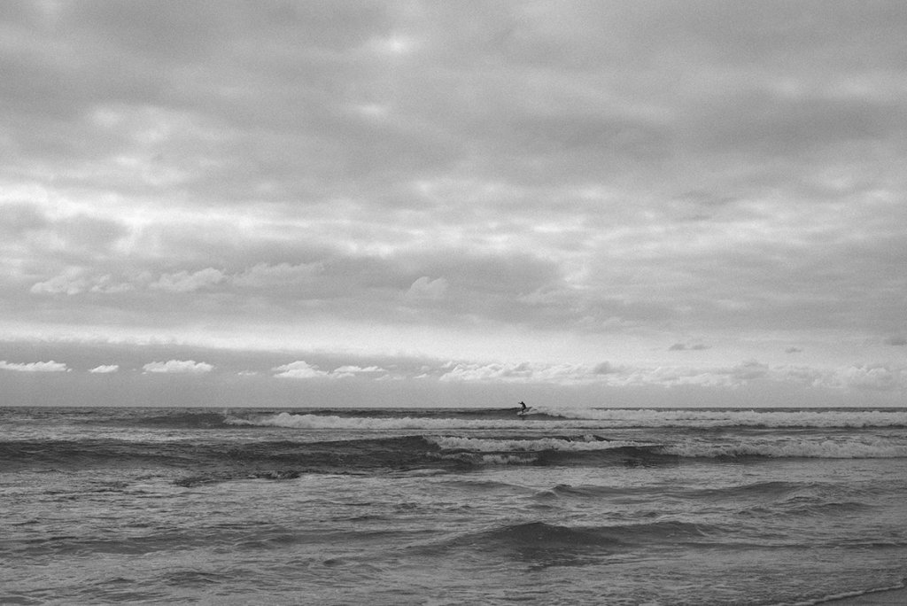 black and white surfer photo