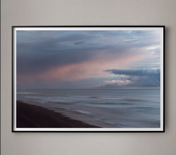 dramatic cloud cover over ocean photograph