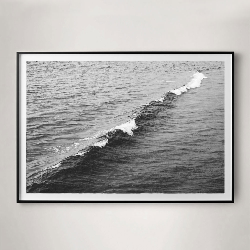 calm minimal black and white ocean photograph