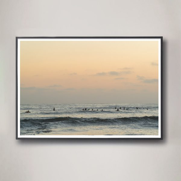 surfers gathering in ocean photograph