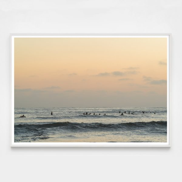 pastel colored photograph with surfers