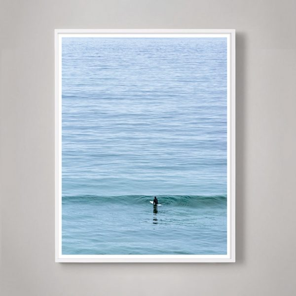 lone surfer in the ocean