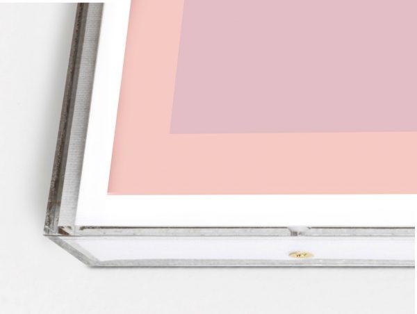 pink geometric art in lucite box frame