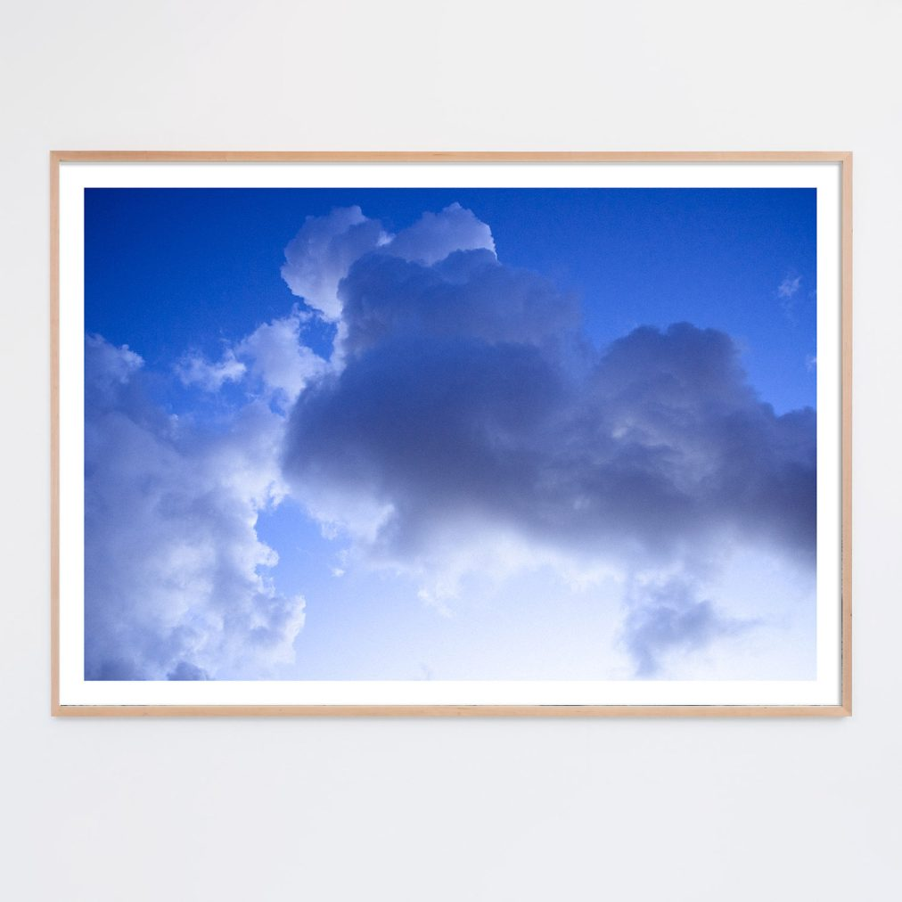 blue clouds photo framed